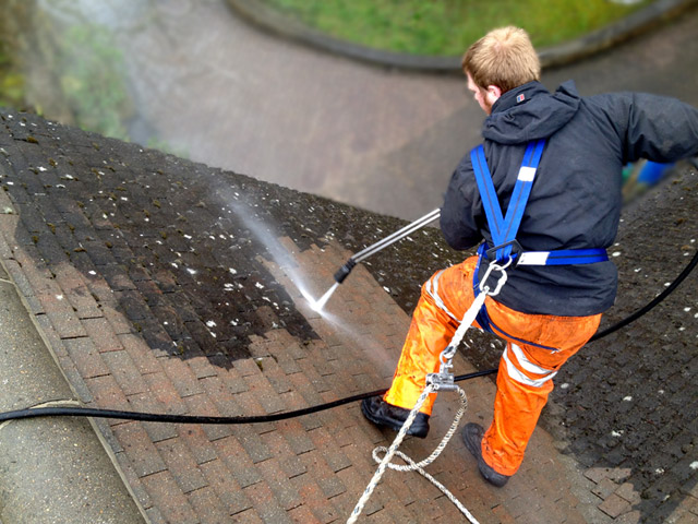 Professional roof cleaning services by Roofman.