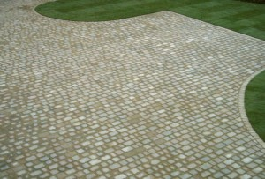 Professional driveway cleaning services by Roofman.