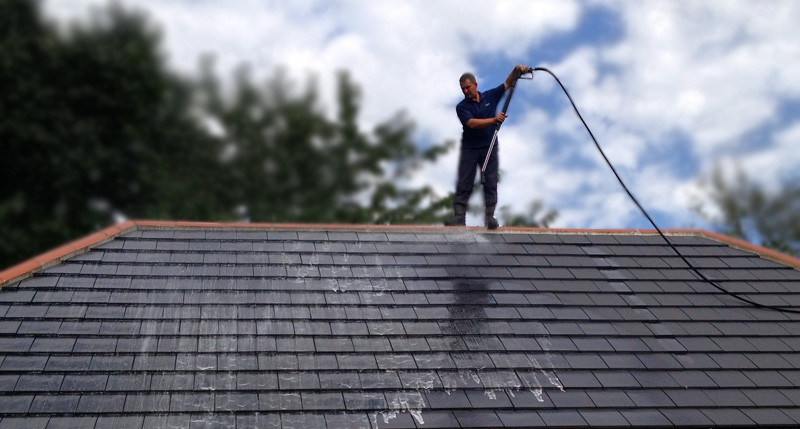 Example of a roof being cleaned and receiving the Roofman fungicidal treatment.