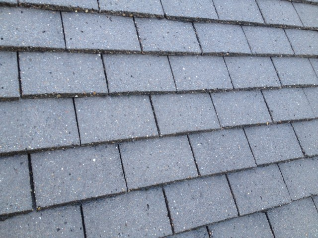 Professional tile replacement services by Roofman.