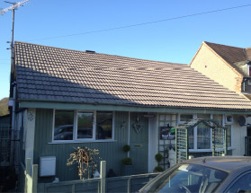 Example of a roof cleaned by Roofman.
